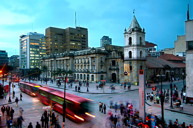 At the intersection of Avendia Jimenez and Carrera Septima, red Transmilenio buses pull into the Museum of Gold station in front of the 16th century Iglesia de San Francisco, Bogota's oldest restored church.