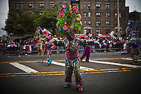 """A """"diablo cojuelo"""" from la vega take part during the Bronx Dominican parade in New York July 28, 2013 by Kena Betancur / VIEWpress"""