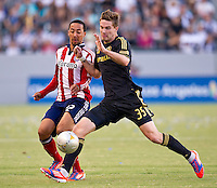 CARSON, CA - July 21, 2012: Chivas USA defender Ryan Smith (22) and LA Galaxy defender Bryan Gaul (35) during the LA Galaxy vs Chivas USA match at the Home Depot Center in Carson, California. Final score LA Galaxy 3, Chivas USA 1.