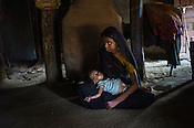 21 year old, Rekha RAMESH sits with her 18 month old Prahlad RAMESH, a recovering malnourished boy in their house in Dhawati VIllage of Khaknar block of Burhanpur district in Madhya Pradesh, India.  Photo: Sanjit Das/Panos for ACF