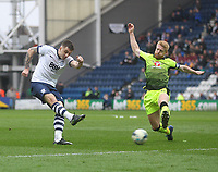 Preston North End's Jordan Hugill gets a shot pasr Reading's Paul McShane<br /> <br /> Photographer Mick Walker/CameraSport<br /> <br /> The EFL Sky Bet Championship - Preston North End v Reading - Saturday 11th March 2017 - Deepdale - Preston<br /> <br /> World Copyright &copy; 2017 CameraSport. All rights reserved. 43 Linden Ave. Countesthorpe. Leicester. England. LE8 5PG - Tel: +44 (0) 116 277 4147 - admin@camerasport.com - www.camerasport.com