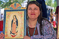 Ellen Chavez de Lietner, a New Mexico artist who specializes in traditional Spanish Colonial art, displays her retablo depicting the Virgin of Guadalupe during the annual Spanish Market held on the plaza in Santa Fe each July