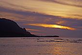 Canoe paddlers at sunset. Hanalei Bay, Kauai