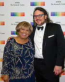 Blues singer Mavis Staples and the leader of the band Wilco, Jeff Tweedy, arrive for the formal Artist's Dinner honoring the recipients of the 39th Annual Kennedy Center Honors hosted by United States Secretary of State John F. Kerry at the U.S. Department of State in Washington, D.C. on Saturday, December 3, 2016. The 2016 honorees are: Argentine pianist Martha Argerich; rock band the Eagles; screen and stage actor Al Pacino; gospel and blues singer Mavis Staples; and musician James Taylor.<br /> Credit: Ron Sachs / Pool via CNP