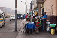 People eat at an informal, roadside restaurant.