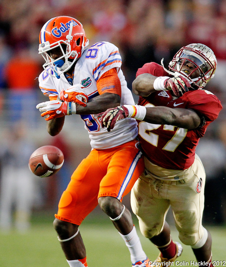 TALLAHASSEE, FL 11/24/12-FSU-UF112412 CH-Florida State's Xavier Rhodes collides with Florida's James Rhoden preventing a pass catch during second half action Saturday at Doak Campbell Stadium in Tallahassee. The Gators beat the Seminoles 37-26..COLIN HACKLEY PHOTO