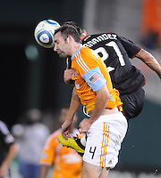Houston Dynamo defender Ryan Cochrane (4) heads the ball against DC United forward Pablo Hernandez (21)  The Houston Dynamo defeated DC United 3-1, at RFK Stadium, Saturday September 25, 2010.