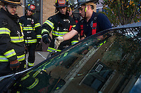 FF Kamil Mizinsky, left, watches as Captain Joe McLean, right, trains AJ Maresca at the 16th Street Fire House of the North Hudson Regional Fire and Rescue in Union City, NJ on November 07, 2013. Many vets say after the military they're still looking for a career with a sense of public service. Some vets have found that at the North Hudson Regional Fire and Rescue in New Jersey.