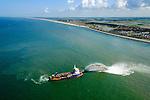 Nederland, Noord-Holland, Gemeente Schoorl, 05-08-2014; Camperduin, Hondsbossche en Pettemer Zeewering. De zeewering is een van de Zwakke Schakels in de kust. Om de dijk te beschermen wordt er door middel van zandsuppletie een strand aangebracht voor de dijk.<br /> De zandsuppletie wordt onder andere uitgevoerd door middel van 'rainbowen', het in zee spuiten van zand+water. Op de foto de sleephopperzuiger Volvox Olympia.<br /> Camperduin, Hondsbossch and Petten dam. The seawall is one of the weak links in the coast. To protect the dike, sand nourishment is used to create a protecting beach.<br /> The sand replenishment is carried out  through &quot;rainbowing ', spraying sand + water into the sea. The photo shows the trailing suction hopper dredger Volvox Olympia.<br /> luchtfoto (toeslag op standard tarieven);<br /> aerial photo (additional fee required);<br /> copyright foto/photo Siebe Swart