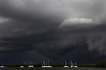A typical summer storm rolls in over the community of people who are living on their boats anchored in Estero Bay.