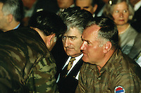 "Yougoslavia. Bosnia. Serbian republic. Bijelina. Radovan Karadzic (L) and General Ratko Mladic (R). Celebration for ""Vidovdan"" day. Each year on the 28th of June, the serbs celebrate the day of the army. Religious service in the orthodox church. Radovan Karadzic was arrested in Belgrade on 21 July 2008. He was extradited to the Netherlands, and is currently in The Hague, in the custody of the International Criminal Tribunal for the former Yugoslavia. General Ratko Mladic is on the list of the International Criminal Tribunal for the former Yugoslavia (ICTY), based in The Hague in the Nederlands, as a most wanted man for war crimes. © 1995 Didier Ruef"