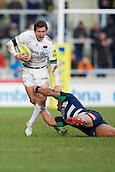 21.02.2015.  Sale, England.  Aviva Premiership Rugby. Sale Sharks versus Saracens. Saracens fullback Alex Goode is tackled by Sale Sharks centre Sam Tuitupou.