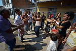 """THIS PHOTO IS AVAILABLE AS A PRINT OR FOR PERSONAL USE. CLICK ON """"ADD TO CART"""" TO SEE PRICING OPTIONS.   Participant dance in the street during a wedding in Suto Orizari, Macedonia. The mostly Roma community, located just outside Skopje, is considered Europe's largest Roma settlement. ."""