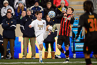 Notre Dame Fighting Irish midfielder Patrick Hodan (27) and Maryland Terrapins midfielder Michael Sauers (3). The Notre Dame Fighting Irish defeated the Maryland Terrapins 2-1 during the championship match of the division 1 2013 NCAA  Men's Soccer College Cup at PPL Park in Chester, PA, on December 15, 2013.