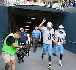Tennessee Titans Matt Hasselbeck, left, and Jake Locker depart the tunnel before their  pre-season game against the Seattle Seahawks a at CenturyLink Field in Seattle, Washington on August 11, 2012. ©2012. Jim Bryant Photo. All Rights Reserved...