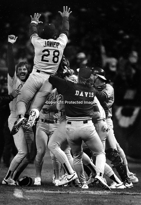 Oakland Athletics celebrate after beating the San Francisco Giants four straight in the 1989 World Series. Jumping Stan Javier, along with Dennis Eckersley (left) and Storm Davis. (1989 photo/Ron Riesterer)
