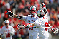 Ohio State's Jesse King (19) celebrates his goal with Ohio State's Reegan Comeault (8) in the third quarter of the NCAA lacrosse game between the Ohio State Buckeyes and Michigan Wolverines at Ohio Stadium in Columbus, Saturday morning, April 12, 2014. The Ohio State Buckeyes defeated the Michigan Wolverines 15 - 6. (The Columbus Dispatch / Eamon Queeney)