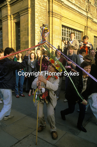 May Day first of May Oxford, man with mobile maypole gets students to celebrate by performing an impromptu maypole dance.  UK