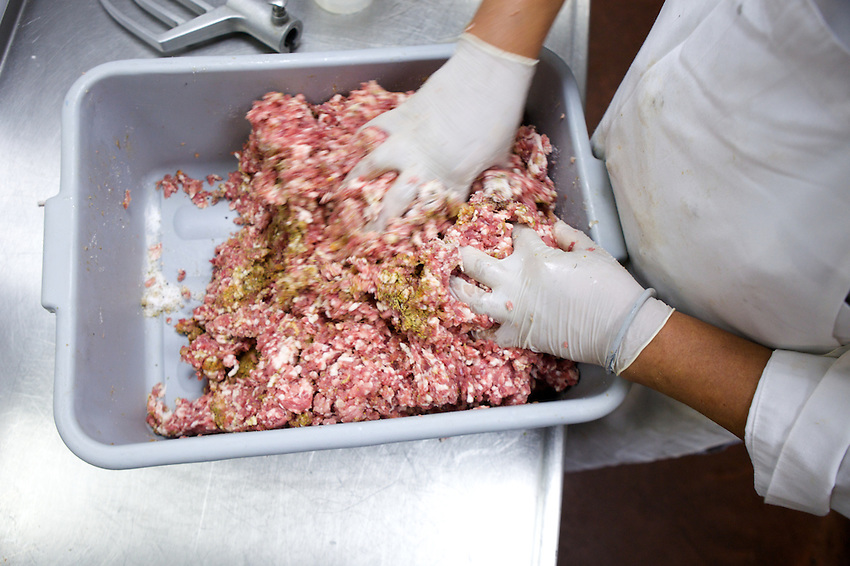 NEW YORK, NY - JULY 29, 2013: Seasoning ground pork for salumi at Il Buco Alimentari in SoHo. CREDIT: Clay Williams for Serious Eats.<br /> <br /> &copy; Clay Williams / http://claywilliamsphoto.com