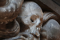 Detail of sculpted skulls from the funerary monument of canon Antoine de Baillon, died 1644, by Nicolas Blasset, 1600-59, in the nave of the Basilique Cathedrale Notre-Dame d'Amiens or Cathedral Basilica of Our Lady of Amiens, built 1220-70 in Gothic style, Amiens, Picardy, France. Amiens Cathedral was listed as a UNESCO World Heritage Site in 1981. Picture by Manuel Cohen