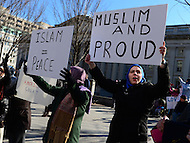 Washington, DC - February 4, 2017: Muslim women hold signs as a few thousand people marched near the White House in the District of Columbia, February 4, 2017, to protest the travel ban instituted by President Trump.  (Photo by Don Baxter/Media Images International)