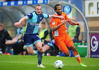 Blackpool's Nathan Delfouneso under pressure from Wycombe Wanderers' Michael Harriman<br /> <br /> Photographer Kevin Barnes/CameraSport<br /> <br /> The EFL Sky Bet League Two - Wycombe Wanderers v Blackpool - Saturday 11th March 2017 - Adams Park - Wycombe<br /> <br /> World Copyright &copy; 2017 CameraSport. All rights reserved. 43 Linden Ave. Countesthorpe. Leicester. England. LE8 5PG - Tel: +44 (0) 116 277 4147 - admin@camerasport.com - www.camerasport.com
