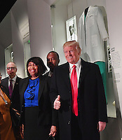 United States President Donald Trump looks at the Ben Carson exhibit with Ben Carson (back,center) as he visits the Smithsonian National  Museum of African American History and Culture in Washington, DC on February 21, 2017.   <br /> Credit: Kevin Dietsch / Pool via CNP /MediaPunch