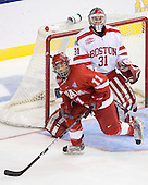 Carter Camper (Miami - 11), Kieran Millan (BU - 31) - The Boston University Terriers defeated the Miami University RedHawks 4-3 in overtime to win the 2009 NCAA D1 National Championship at the Frozen Four on Saturday, April 11, 2009, at the Verizon Center in Washington, DC.