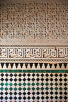 Berber Mocarabe Honeycomb work plaster decorations and Berber design tiles of the 17th century Berber Pavillion of the Ambassadors built Sultan Moulay Ismail.   A UNESCO World Heritage Site .Meknes, Meknes-Tafilalet, Morocco.