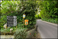 BNPS.co.uk (01202 558833)<br /> Pic: GrahamHunt/BNPS<br /> <br /> Sign put up by frustrated locals.<br /> <br /> A sleepy Dorset village is getting jammed up to 18 times a week with big lorries after highways officials deliberately directed them to drive through it in a controversial traffic experiment.<br /> <br /> The 'unbelievable' strategy has brought havoc and misery to Melbury Abbas where villagers are getting used to the sight of a 30 tonne HGV blocking the narrow main road.<br /> <br /> Cars heading through the pretty hamlet face delays of up to an hour whenever a hapless trucker attempts to pass another large vehicle using the C13.<br /> <br /> Kerbs, grass verges and a water hydrant have been badly damaged by truckers mounting them to create space to squeeze though, while one HGV came within just 2ins of colliding with a Grade II listed property on one occasion.