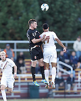 Brown University defender Ryan McDuff (5) battles for a head ball. Brown University (black) defeated Boston College (white), 1-0, at Newton Campus Field, October 16, 2012.