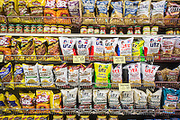 A display of tasty snacks including Utz brand products are seen in a supermarket in New York on Monday, September 22, 2014.  (© Richard B. Levine)