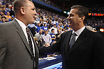 UK head coach John Calipari talks with Campbellsville head coach before the start of the first exhibition game of the season on Monday, Nov. 2, 2009. Photo by Britney McIntosh | Staff