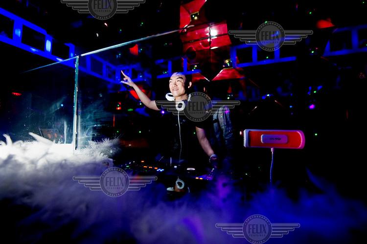 A DJ plays at LeZaZou nightclub.
