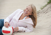teenage girl having a good laugh while on the beach