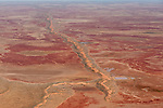 Aerial - Sturt Stoney Desert with gibber rocks. Gibber rocks are millions of years wind and water weathered chalcedonised sandstone with a hardened crust of soil cemented silica, iron and manganese