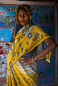 8 month pregnant woman, Suganti poses for a photo while waiting to meet sister mary Elise (not in picture) and consult on pregnancy issues as part of the health consultancy camp provided by Fakirana Sisters Society in Chanayan bandh Musahar Tola Village, in Bettiah of West Champaran district in Bihar. Since 2008 the Foundation and Geneva Global have been investing in the training of medical staff to improve the lives of people living in 600+ villages in the region. The NGOs are delivering cost effective interventions to address treatment, care and prevention of diseases, disability and preventable deaths amongst infants, adolescent girls and women of child-bearing age. There is statistical and anecdotal evidence that there have been vast improvements and a total of 40-50% increased immunization for all children under 6 has meant that communities can be serviced and educated long term. Photograph: Sanjit Das/Panos for Legatum Foundation