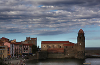 Eglise Notre Dame des Anges, Collioure, France, in the evening. The bell tower was converted from a medieval lighthouse and the Mediterranean Gothic style nave was built in 1684. The dome was added to the bell tower in 1810. Picasso, Matisse, Derain, Dufy, Chagall, Marquet, and many others immortalized the small Catalan harbour in their works. Picture by Manuel Cohen.