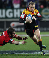 Crusaders' Samuel Whitelock makes a dive at Chiefs' Robbie Robinson in the semi-final Super Rugby match, Waikato Stadium, Hamilton, New Zealand, Friday, July 27, 2012.  Credit:SNPA / David Rowland
