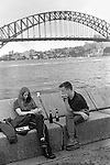 Young couple with Sydney harbour bridge. Australia.