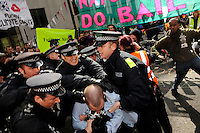 Police make an arrest outside the Climate Camp. Thousands of protestors descended on the City of London ahead of the G20 summit of world leaders to express anger at the economic crisis, which many blame on the excesses of capitalism.