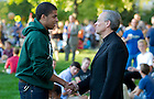 August 21, 2012; Rev. John I. Jenkins, C.S.C., president of the University of Notre Dame, chats with a student at a picnic on DeBartolo Quad following opening Mass. Photo by Barbara Johnston/University of Notre Dame