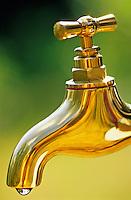 Brass tap dripping water.
