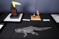 Origami toucan, skunk and seahorse, and alligator designed and folded by Michael LaFosse on display at the OrigamiUSA 2013 Convention exhibition