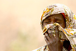 A woman weeps as she tells how her village was attacked by government-aligned militias in the Darfur region of Sudan.
