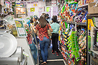 """Customers in the Makey Deli in the South Bronx in New York on Thursday, September 19, 2013. A program of City Harvest and Ironwill, """"Healthy Neighborhoods""""  endeavors to improve access to fruits and vegetables in neighborhoods that are """"food deserts"""", providing the primarily low income residents with access to affordable healthy food choices. (© Richard B. Levine)"""