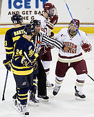 Glenn Cooke separates Stephane Da Costa (Merrimack - 24) and Cam Atkinson (BC - 13). - The Boston College Eagles defeated the visiting Merrimack College Warriors 3-2 on Friday, October 29, 2010, at Conte Forum in Chestnut Hill, Massachusetts.