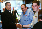 Chicago, Il - November 21, 2008 -- United States President-elect Barack Obama greets workers at Manny's Coffee Shop and Deli during a lunch break from his transition office at the federal building, Friday, November 21, 2008 in Chicago, Illinois. Obama ordered a corned beef sandwich and greeted customers before leaving the restaurant. .Credit: Scott Olson - Pool via CNP