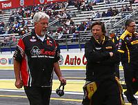 Feb 9, 2014; Pomona, CA, USA; NHRA funny car driver Del Worsham (right) with father Chuck Worsham during the Winternationals at Auto Club Raceway at Pomona. Mandatory Credit: Mark J. Rebilas-