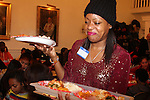 Designer Tracy Reese and Actress serves dinner - Hearts of Gold links to a better life celebrates Christmas with a party #2 for mothers and their children on December 17, 2016 in New York City, New York with arts and crafts, a great turkey dinner with all the goodies and then the children met Santa Claus and had a photo with him as he gave them gifts. (Photo by Sue Coflin/Max Photos)